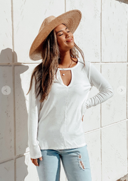 Woman white ribbed long sleeve top with front key hole detail