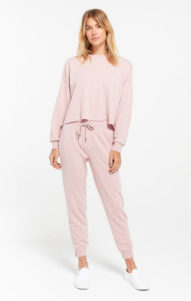 Woman wearing pink long sleeve pullover in french terry fabric