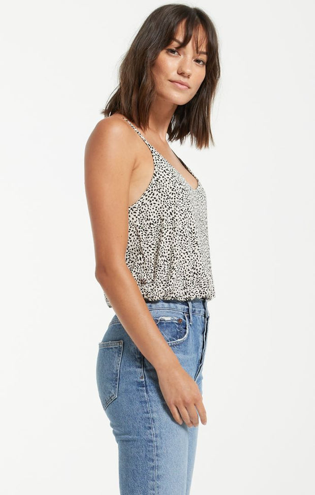 Woman in leopard printed tank top with spaghetti straps, v neck, elastic and slouchy hem