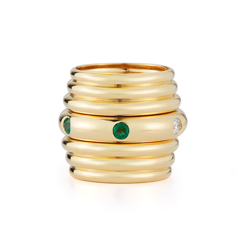 18k yellow gold stacking ring with diamond and emerald rounds.
