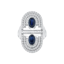 18k white gold ring set with white diamonds and two blue sapphire oval cut center stones.