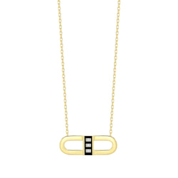 18k yellow gold pendant with black enamel and baguette diamonds.