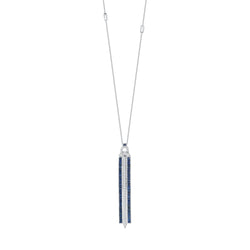 18k white gold pendant set with white diamonds and blue sapphire baguettes. 24 inch chain set with three baguettes.