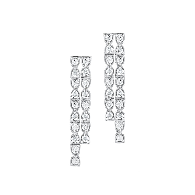 Flexible fringe earrings made with 18k white gold set with white diamonds.