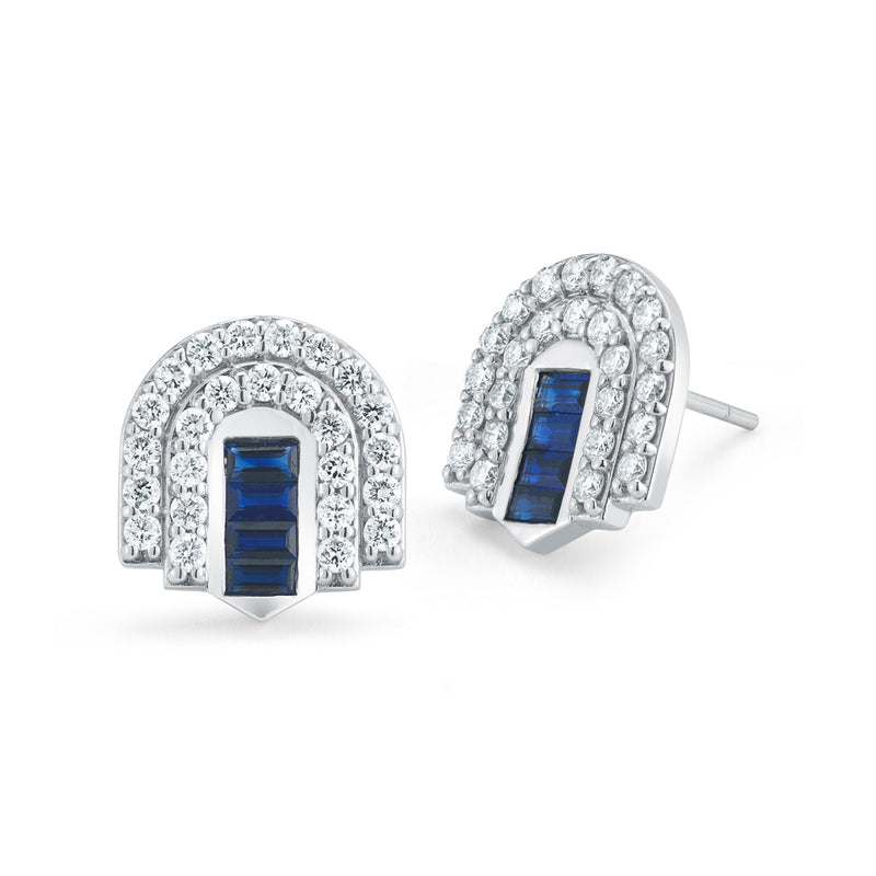 18k white gold stud earrings set with white diamonds and blue sapphire baguettes.