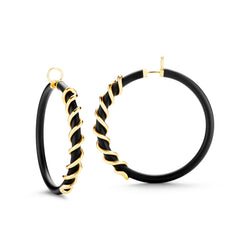 Large black Caucciù hoop earrings with 18K yellow gold coil pill.