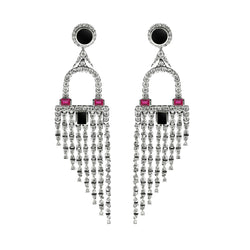 18K white gold earrings with white diamonds, onyx, and rubies.
