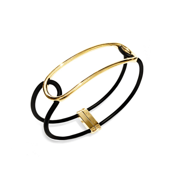 Black Caucciù bracelet with interlocked 18K yellow gold pill.
