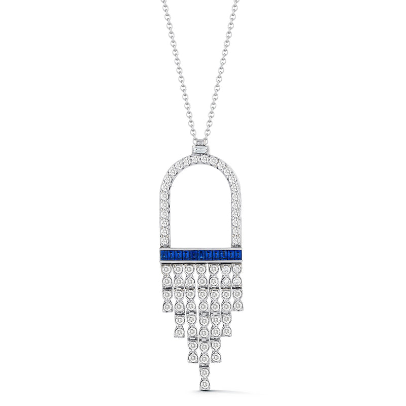 18k white gold flexible fringe pendant with white round diamonds and blue sapphire baguettes. Attached to 18 inch chain.