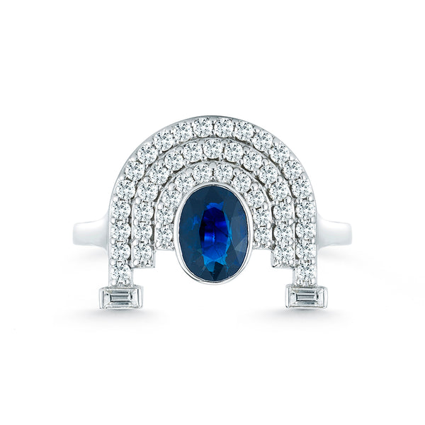 18k white gold ring set with white diamonds and one blue sapphire oval cut center stone.