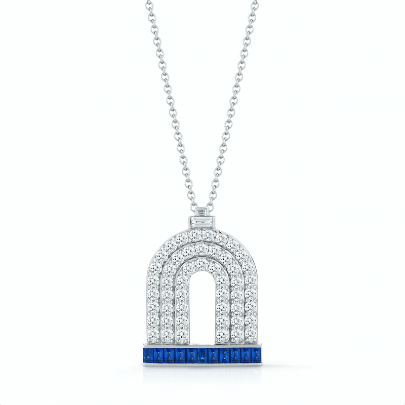 18k white gold pendant with white round diamonds and blue sapphire baguettes. Attached to 18 inch chain.