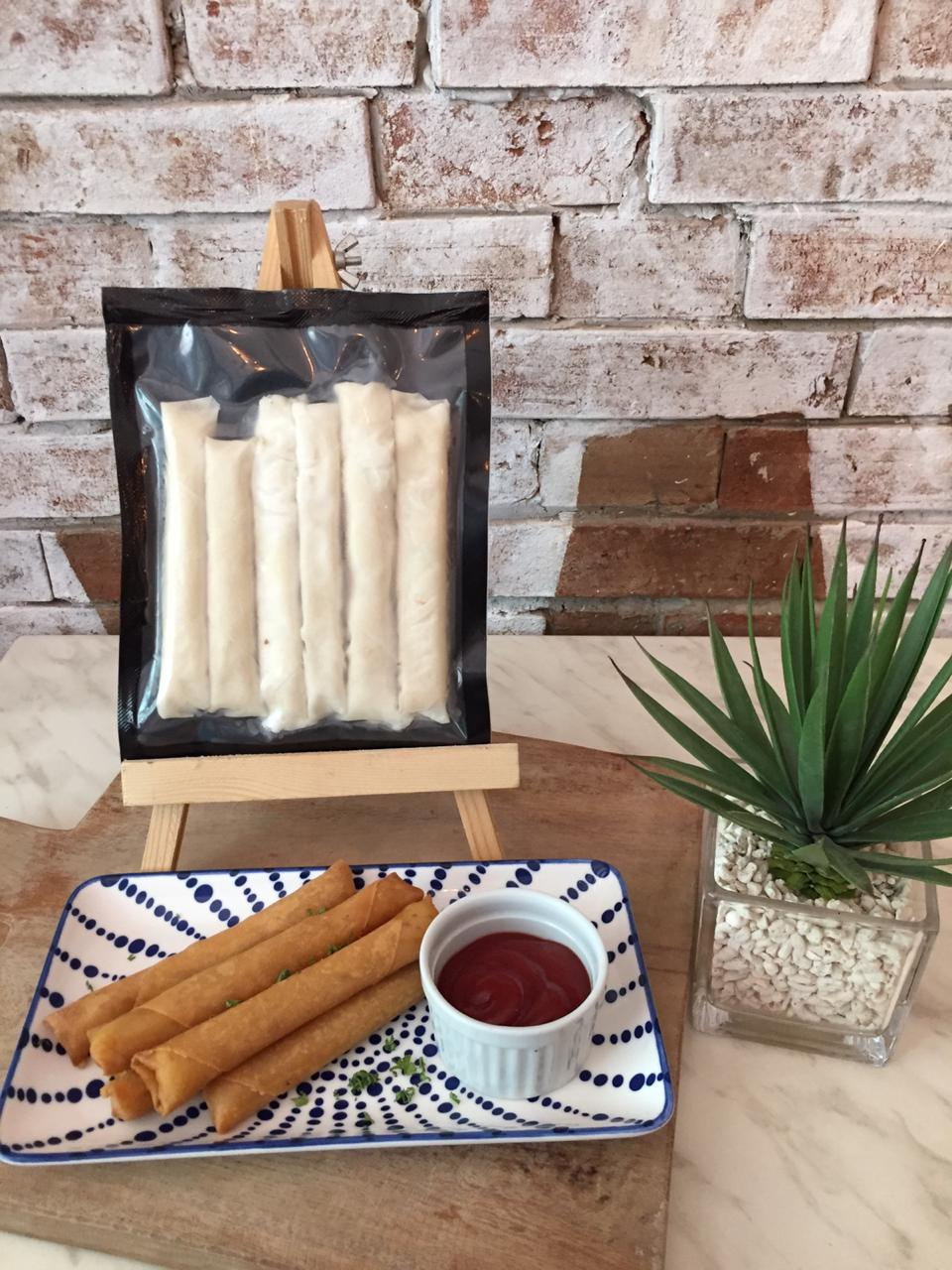 Vegan cheese rolled in a crispy lumpia springroll wrapper.