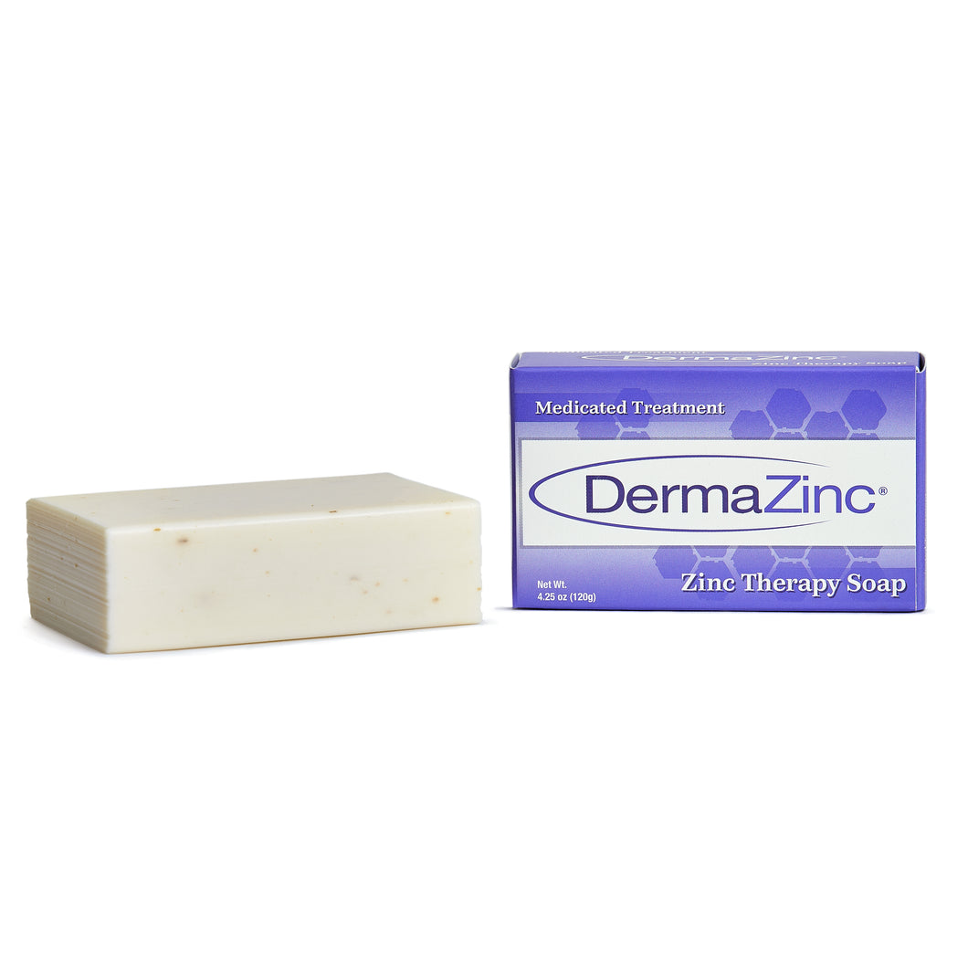 Bar of DermaZinc soap (Left) next to packaging (right)