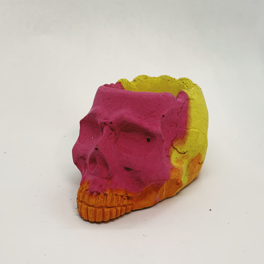 Pink, Yellow, and Orange Concrete Skull Object
