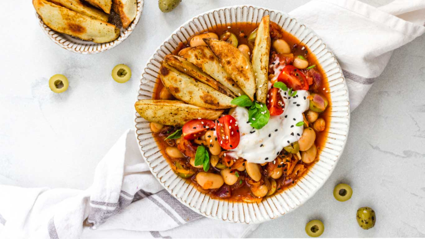 Recipe | Mediterranean Olive & Butterbean Stew with Crispy Wedges by Nourishing Amy & Olly's