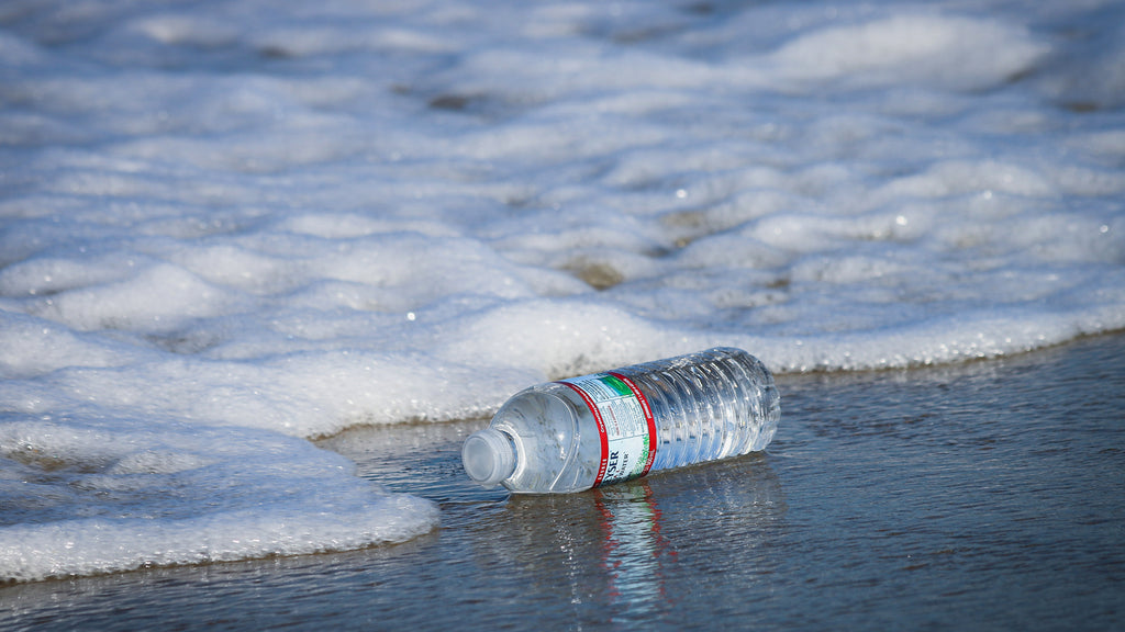 Plastic water bottle on the beach