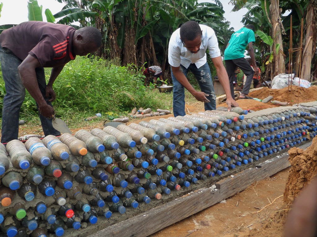 myEnvironment myWealth are building an entire library using plastic bottles stuffed with mud