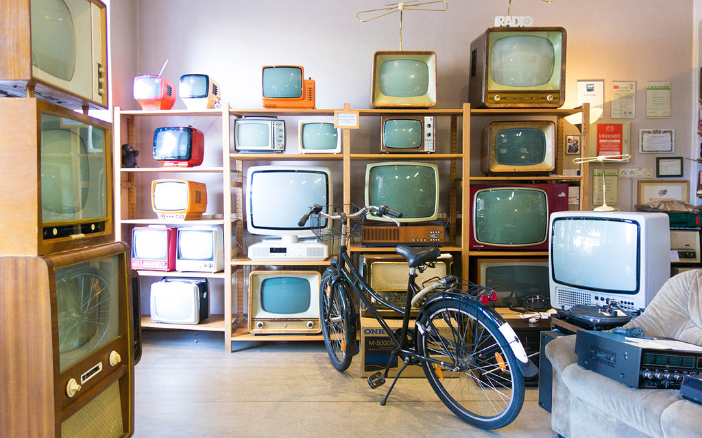 Vintage TV sets in a thrift store
