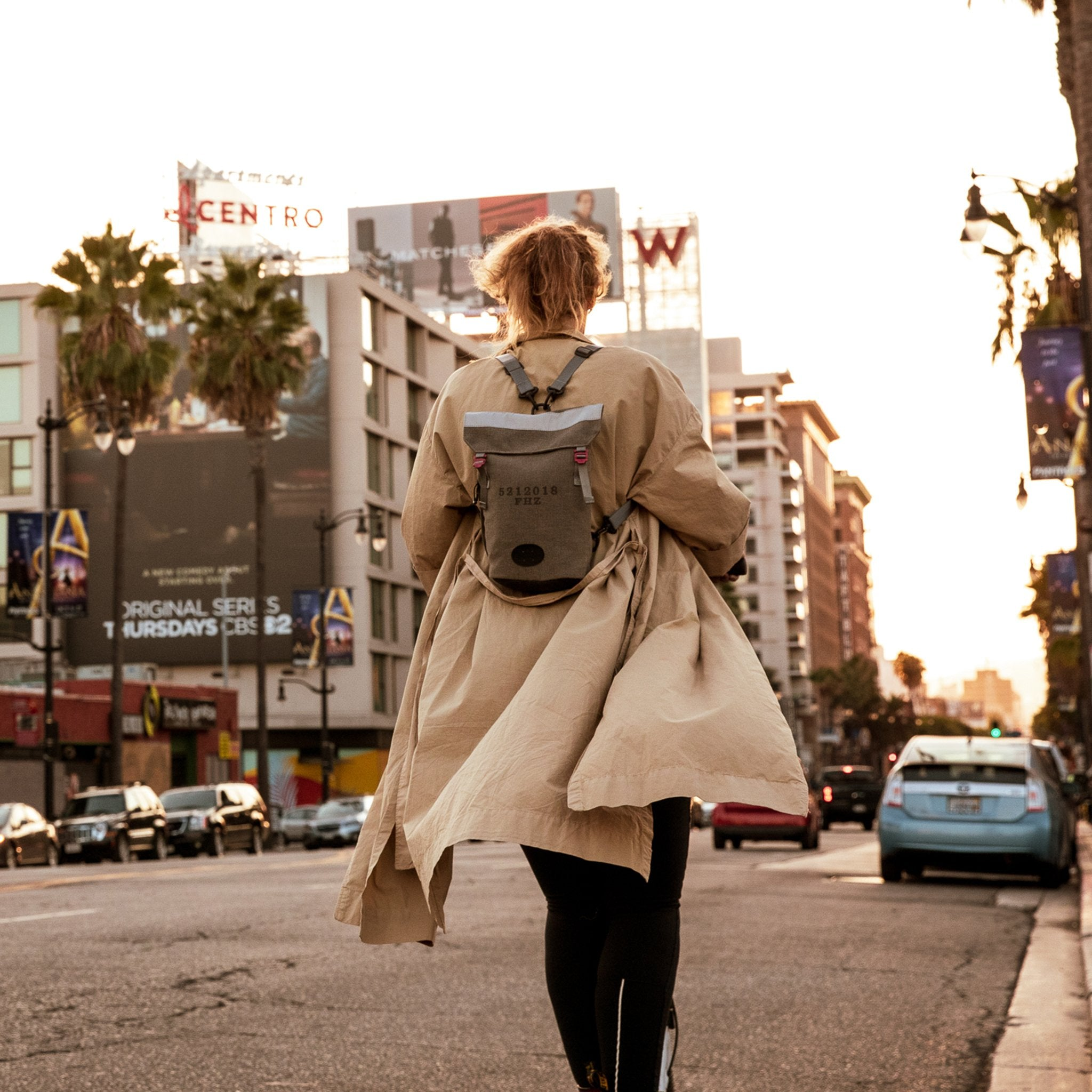 Woman on scooter with a Fierce Hazel convertible backpack in Los Angeles California. It is durable, water-resistant, lightweight and strong
