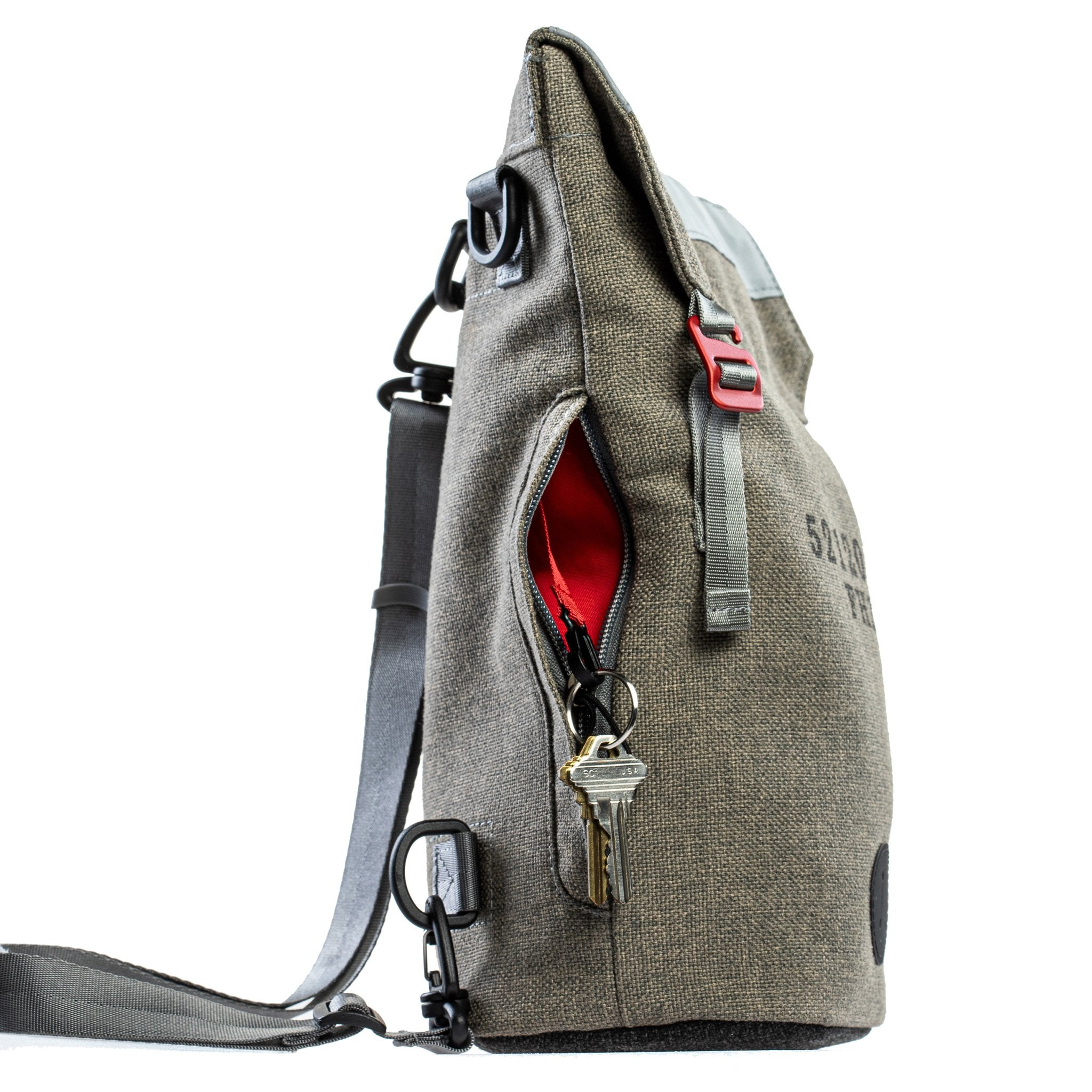 Side view of a Fierce Hazel convertible backpack made with sustainable fabric. Red interior and key clip. Functional, rugged and water-resistant it is military styled but beautiful