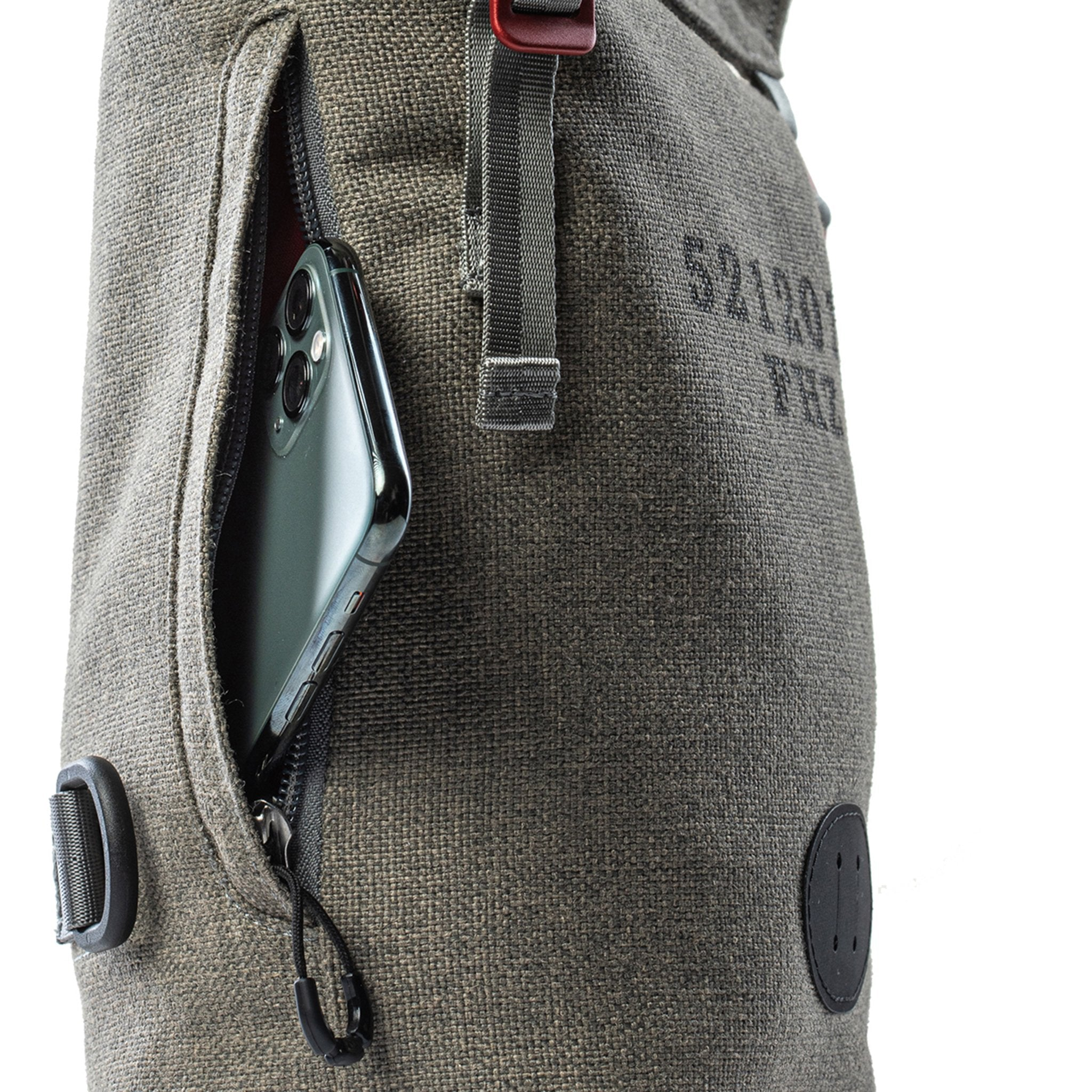 Phone zipper pouch on a Fierce Hazel gender-neutral shoulder bag and convertible backpack. Sling pack and camera bag
