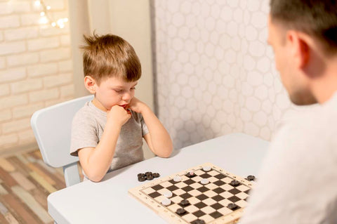 kid playing Board game- Educational Benefits of board game for kids
