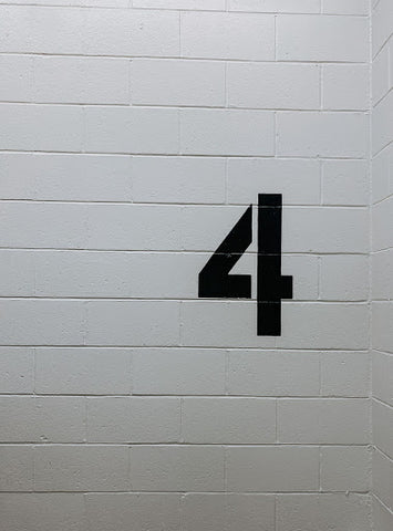 number 4 painted on a wall