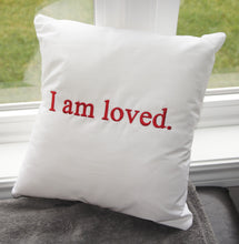 "Load image into Gallery viewer, Empowerment Pillow embroidered with ""I am loved"" 100% cotton with poly fill. Secret pocket to add that extra special message."