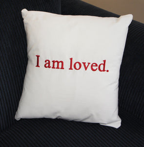 "Empowerment Pillow embroidered with ""I am loved"" 100% cotton with poly fill. Secret pocket to add that extra special message."