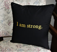 "Load image into Gallery viewer, Empowerment Pillow embroidered with ""I am strong"" 100% cotton with poly fill. Secret pocket to add that extra special message. 14""x14"""