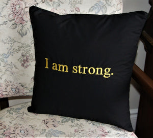 "Empowerment Pillow embroidered with ""I am strong"" 100% cotton with poly fill. Secret pocket to add that extra special message. 14""x14"""