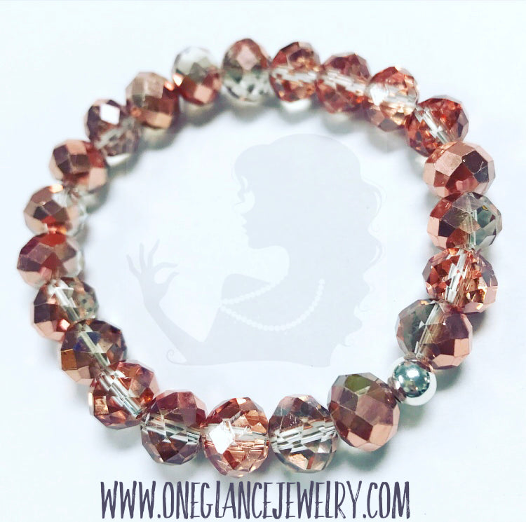 Two tone rose gold crystal stretch bracelet with silver accent