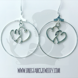 Silver hoop earrings with heart