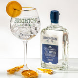 Brighton Gin & Tonic using our navy strength gin served with a slice of orange
