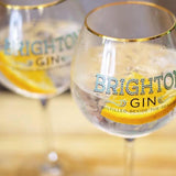 Classic Brighton Gin & Tonics with slice of orange served in copa gin glasses