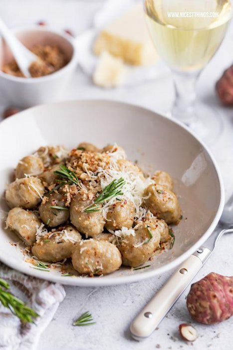 Jerusalem artichoke gnocchi with clams sauce and pumpkin seed powder