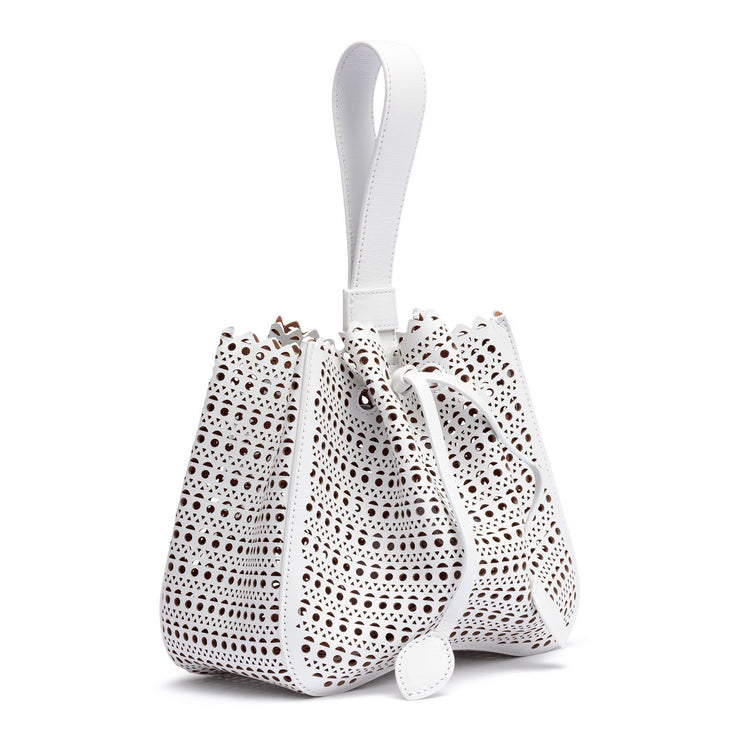 White laser-cut leather bucket bag