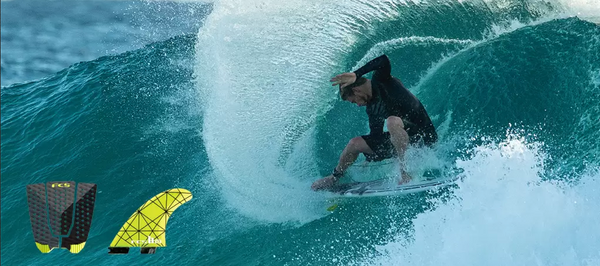FCS Surfer Kolohe Andino with FCS fins and tail pad