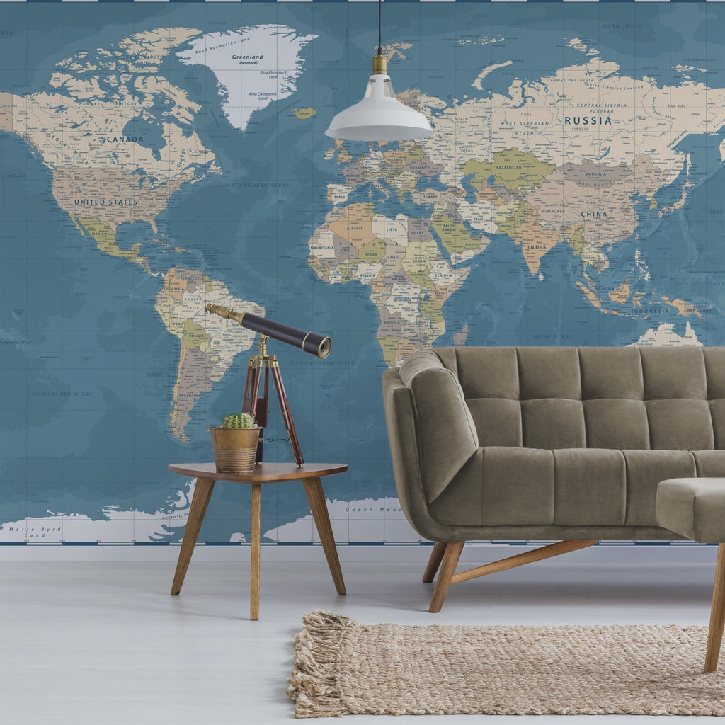 Blue World Map Wallpaper Mural with a couch and telescope in front | WallpaperMural.com