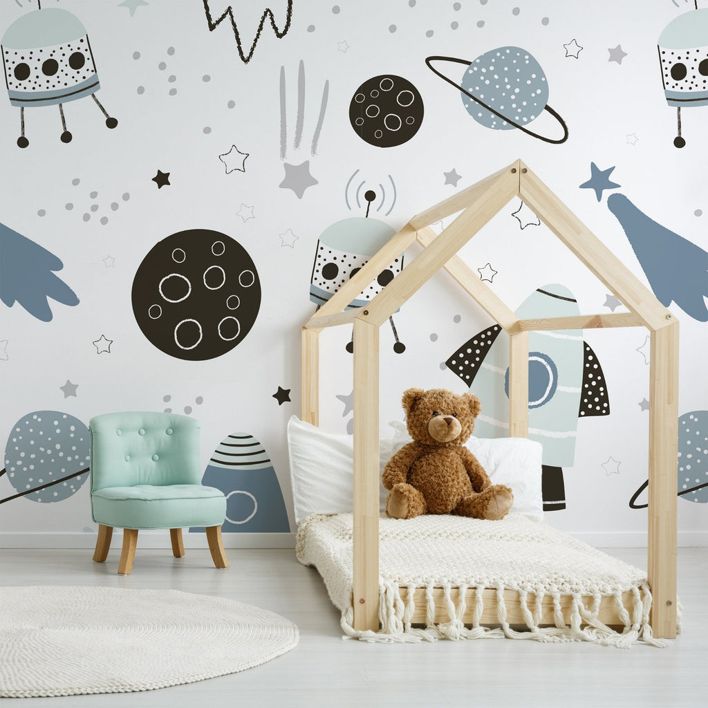 Leo wallpaper mural with a teddy bear in a wooden framed house and a Green chair | WallpaperMural.com