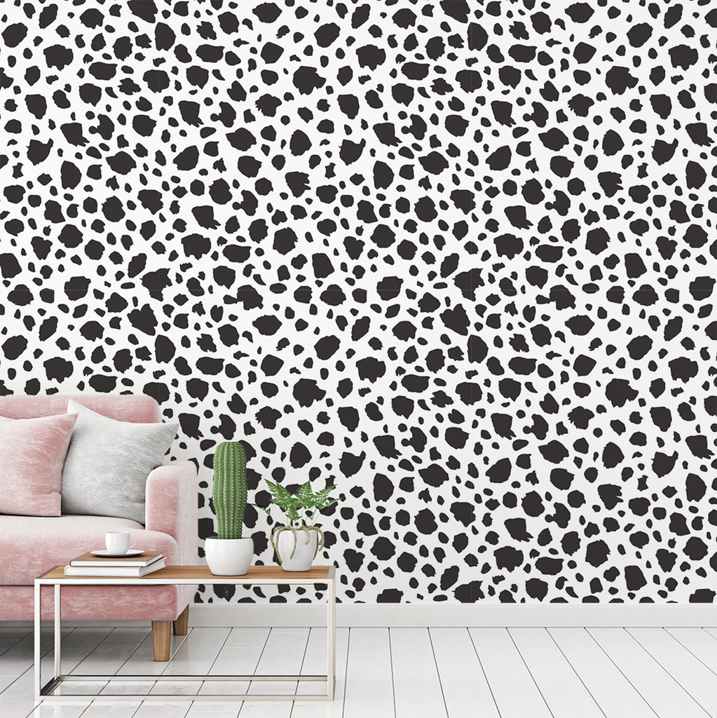 Mottle wallpaper mural with a Pink settee and cactus on a table | WallpaperMural.com