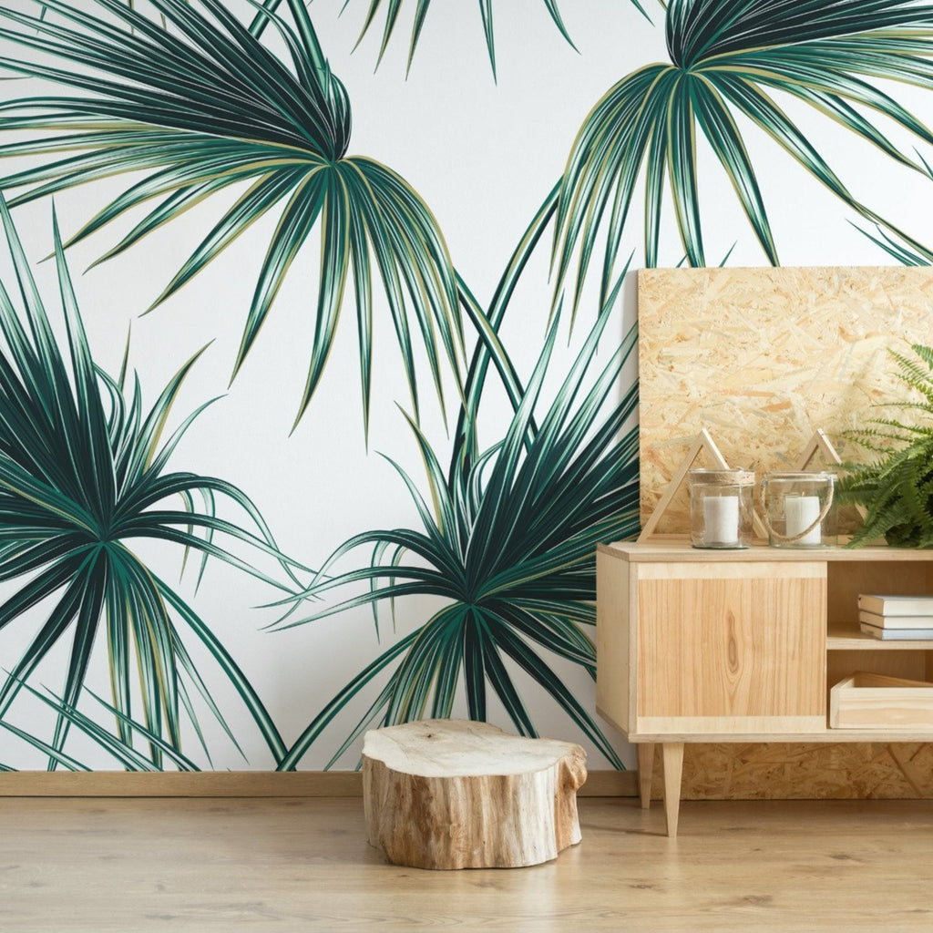 Palm Leaves wallpaper mural with a wooden sideboard and tree trunk | WallpaperMural.com