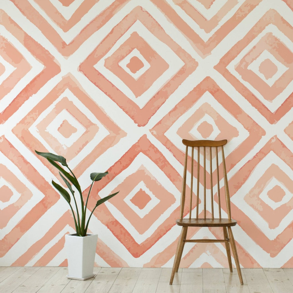Peach wallpaper mural with a wooden chair and a plant | WallpaperMural.com