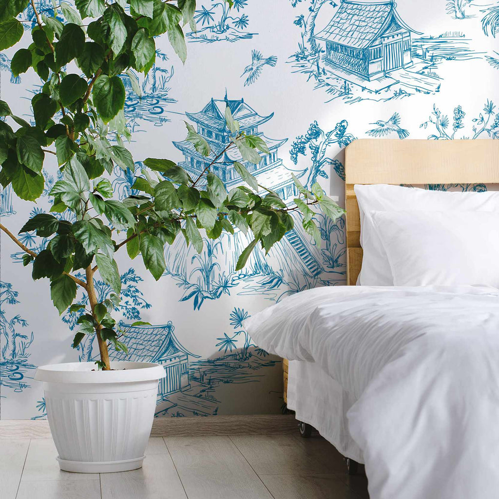 Noelind wallpaper mural in a bedroom with a plant | WallpaperMural.com