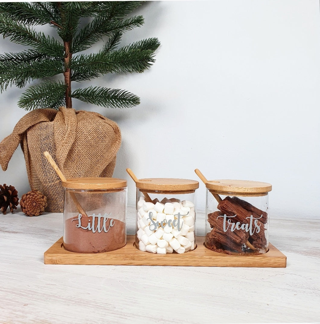 Set of 3 Glass Jar with Bamboo Lid, Spoon & Tray, with custom personal sable wording on the front, containing sweet treats.