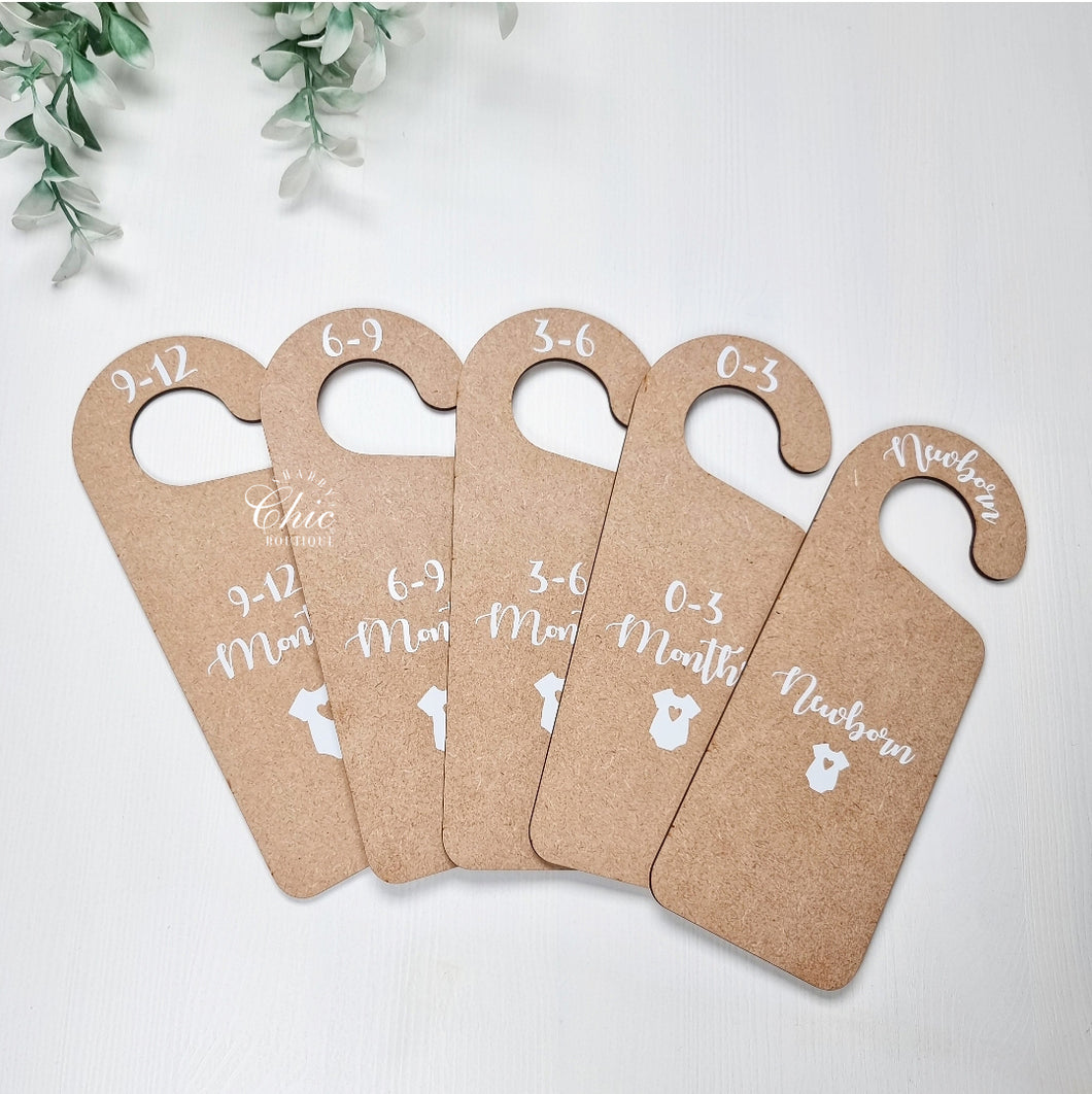 Wooden baby clothes dividers with wording for each age