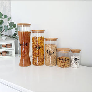 Labelled Glass Jars with Bamboo Lids of varying sizes, with custom personalised wording on the face of the glass.