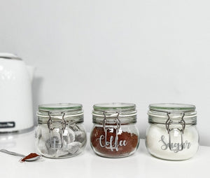 Three airtight glass canisters with custom personalised wording.