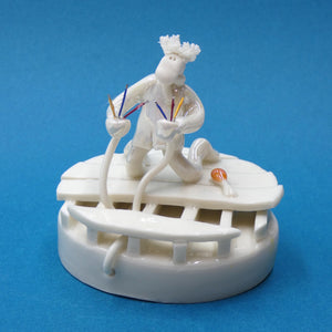 Porcelain sculpture of an electrician with zapped hair by artist Andrew Bull