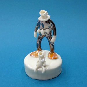 Porcelain sculpture of scuba diver and cat by artist Andrew Bull